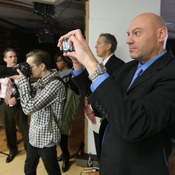 Christian Foury, a senior French health official, takes a photo of a hospital room of the future designed with new technology and a user-friendly touch screen during a tour of Intermountain Healthcare in Murray on Wednesday, Jan. 27, 2016. The French officials were in Utah to learn about how care is delivered here.