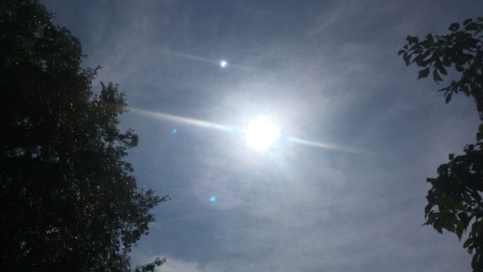 What?s that weird speck in my eclipse photo?
