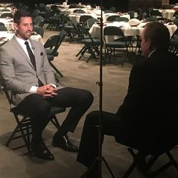 Former BYU tight end and current Baltimore Raven Dennis Pitta speaks with TV personality Dave Fox prior to the 23nd annual banquet for the Utah Chapter of the National Football Foundation on Wednesday, April 12, 2017, at UVU's UCCU Center.