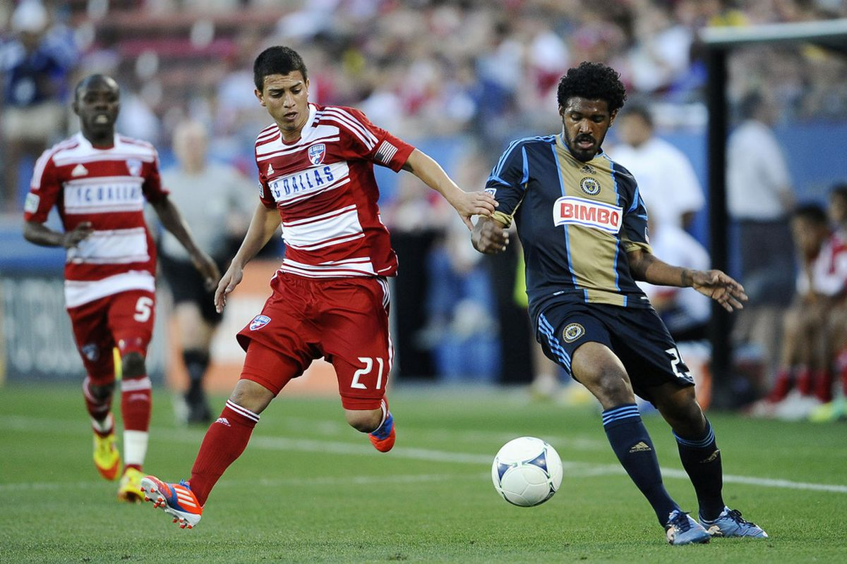 May 19, 2012; Frisco, TX, USA; FC Dallas midfielder Bryan Leyva (21) and Philadelphia Union defender Sheanon Williams (25) fight for the ball during the first half at FC Dallas Stadium. Mandatory Credit: Jerome Miron-US PRESSWIRE