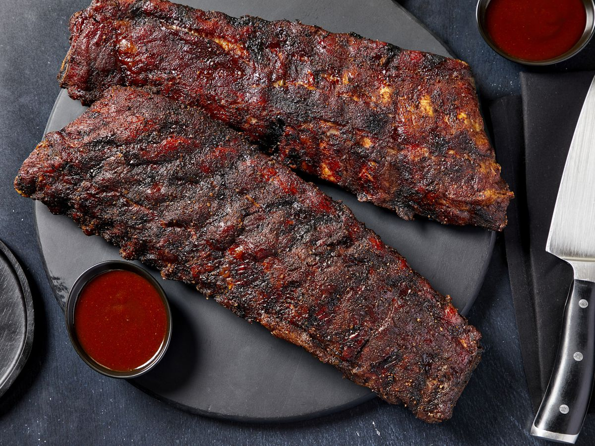 Two slab of pork ribs on a plate.