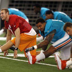 Jul 22, 2013; Davie, FL, USA;  Miami Dolphins quarterback Ryan Tannehill (17) stretches during  training camp at the Doctors Hospital Training Facility at Nova Southeastern University.