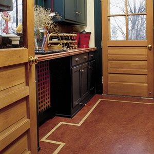 """<p>Sheet linoleum with a custom inlaid border covers the mudroom floor of<br> the 1993 This Old House project house, a 1906 Shingle Style<br> in Belmont, Massachusetts. Six years later, Tom Silva says, """"There's not a sign of wear anywhere. It looks just like the day it was installed.</p>"""