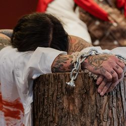 The hands of Isaac Bucio, who plays Jesus Christ, are chained during Via Crucis at Providence of God Church in Pilsen, Friday morning, April 2, 2021. The annual Via Crucis is a Good Friday tradition that reenacts the Stations of the Cross, a Catholic devotion that recounts Jesus' passion and death.