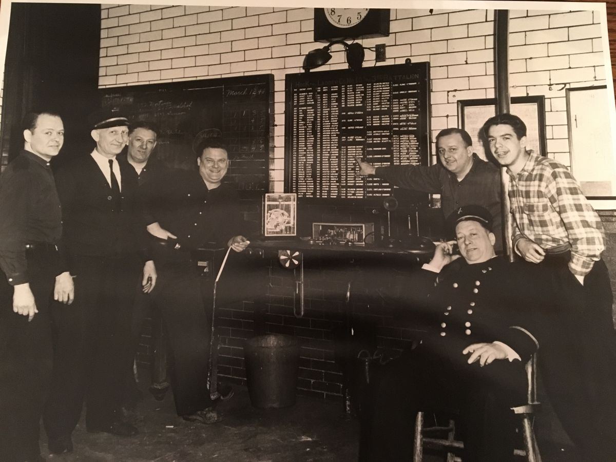 Young Ken Little (right) liked to hang around firehouses and listen to the alarm calls.   Provided photo