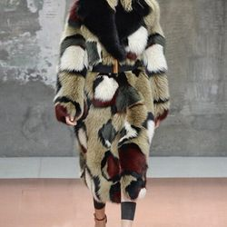 You can rely on Marni to ignite the Sunday morning slot in Milan. Not with a circle of fire like Roberto Cavalli—nothing so literal would ever cross the mind of Marni's Consuelo Castiglione—but in the sense of strong, imaginative clothes that make magazin