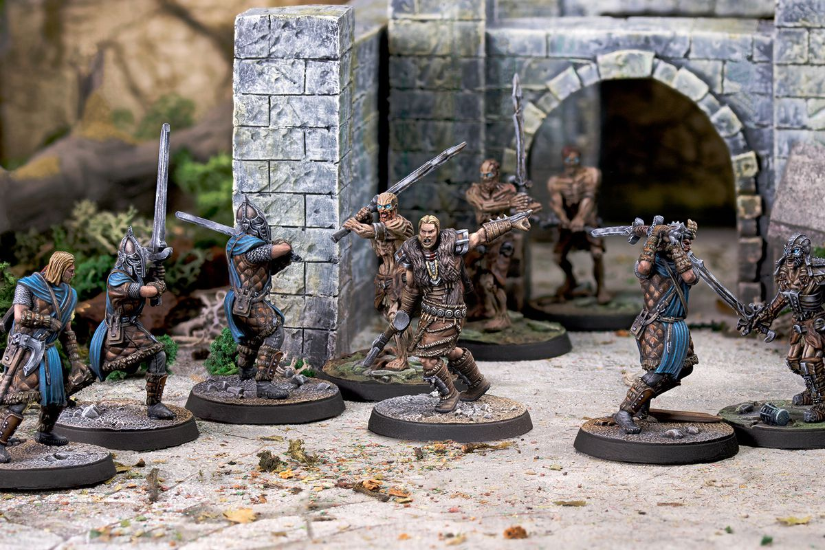 Stormcloaks battle Draghr at the entrance to a tomb in an early piece of key art for The Elder Scrolls miniatures game from Modiphius.