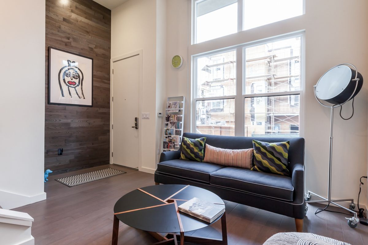 """The entranceway of Dean Tomarat's new townhouse at the San Francisco Shipyard, featuring a painting by Hunters Point artist Tanya Joyce. Photos via <a href=""""http://www.patriciachangphotography.com"""">Patricia Chang</a>"""