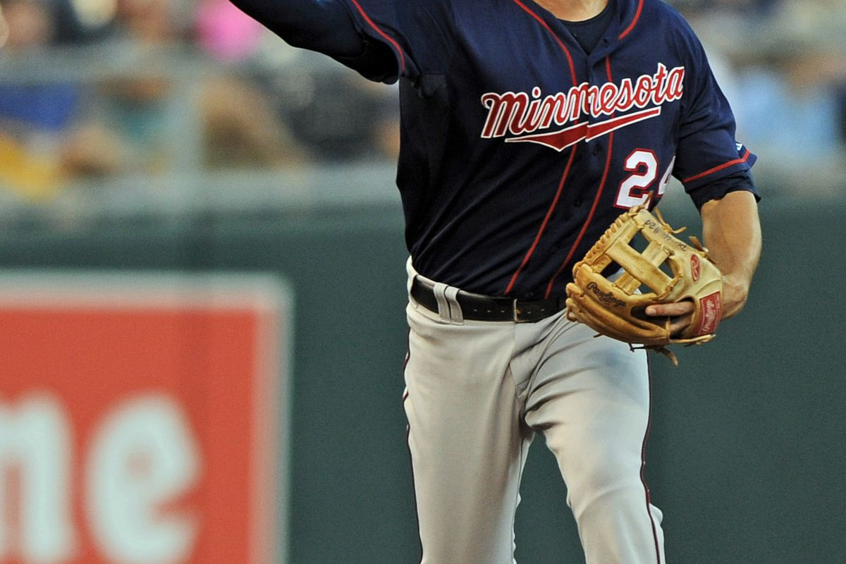 July 20, 2012; Kansas City, MO, USA; Minnesota Twins third basemen Trevor Plouffe (24) makes a throw to first for an out against the Kansas City Royals during the fourth inning at Kauffman Stadium.  Mandatory Credit: Peter G. Aiken-US PRESSWIRE