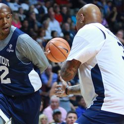 Taliek Brown throws the behind the back pass in front of Charlie Villanueva