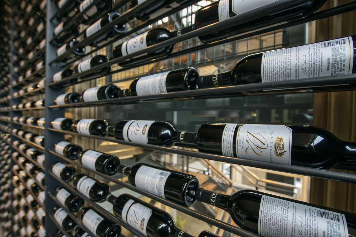A rack filled with different wine bottles.