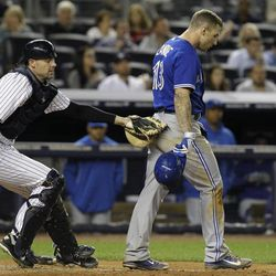 New York Yankees catcher Chris Stewart, left, tags out Toronto Blue Jays' Brett Lawrie who struck out swinging in the eighth inning the Blue Jays' 2-1 loss in Game 2 of their baseball doubleheader at Yankee Stadium in New York, Wednesday, Sept. 19, 2012.