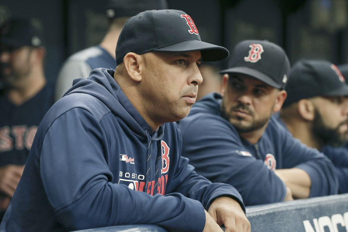 Boston Red Sox manager Alex Cora (20) looks on from the bench during the first inning against the Tampa Bay Rays at Tropicana Field.