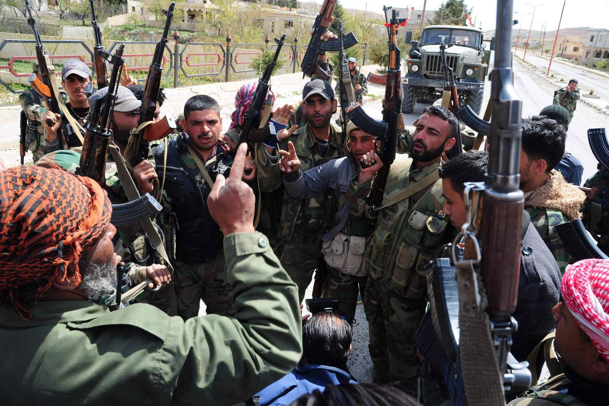 These Syrian government fighters pose with the weapons they already have.