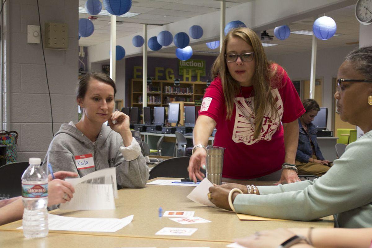 Rhiannon Wenning leads a community forum at Jefferson Junior-Senior High School in Edgewater.