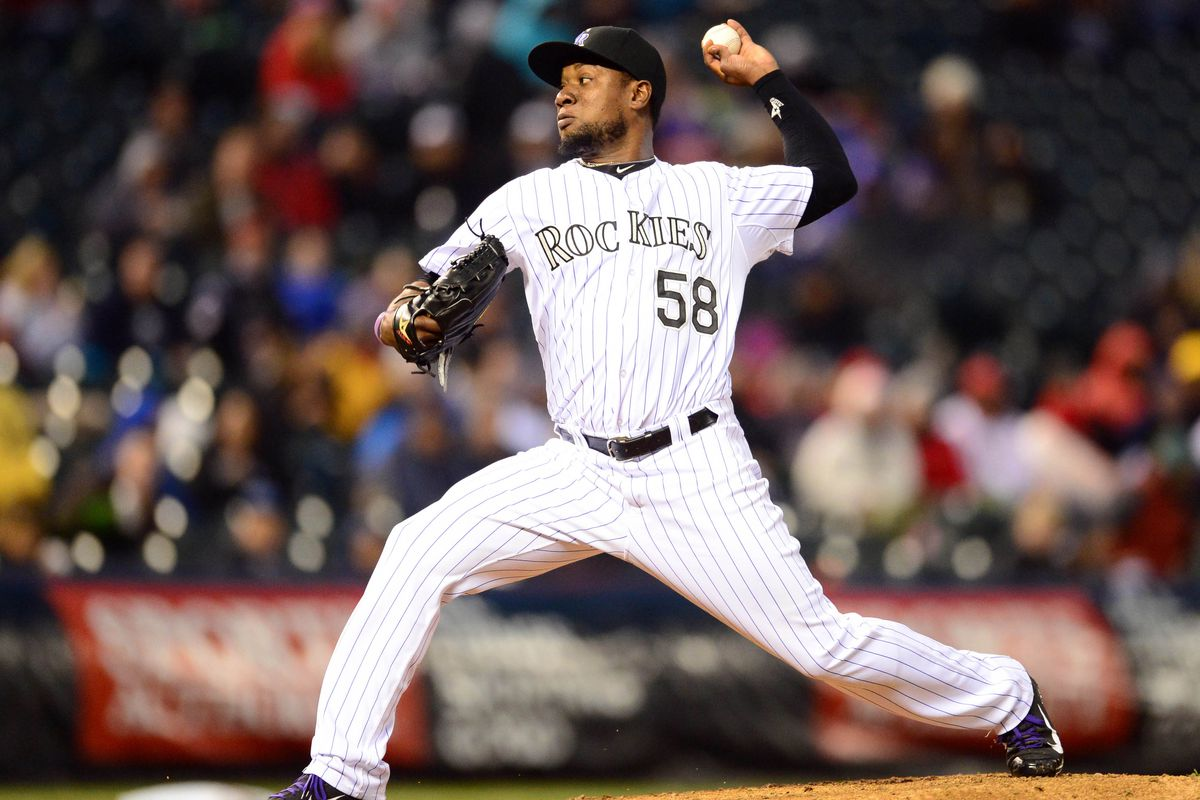 Former Rock Cat pitcher Yohan Flande pitches against the Phillies at Coors Field