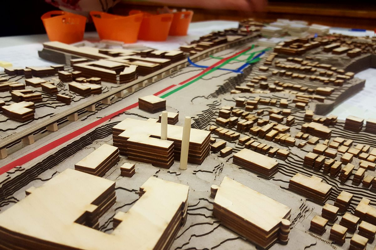 a picture of a wooden model of the yard and its surroundings
