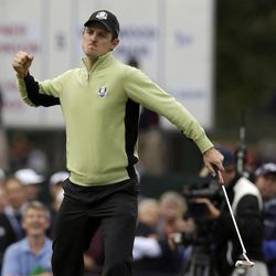 Europe's Justin Rose reacts after making a putt on the fourth hole during a foursomes match at the Ryder Cup PGA golf tournament Friday, Sept. 28, 2012, at the Medinah Country Club in Medinah, Ill.