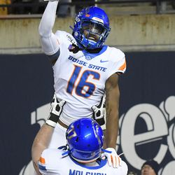 Boise State wide receiver John Hightower (16) celebrates with offensive lineman John Molchon (77) after scoring a touchdown against Utah State during the first half of an NCAA college football game Saturday, Nov. 23, 2019, in Logan, Utah.