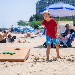Leon Nobile plays bags at Oak Street Beach on July 24, 2019.