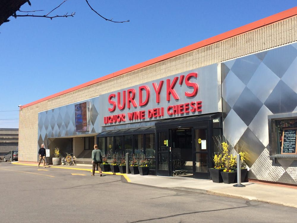 The gray and brushed metal exterior of Surdyk's blends art deco with 80s industry style.