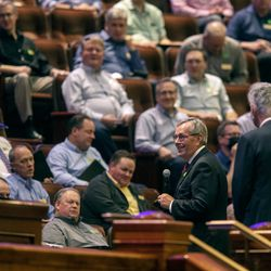 New choir president Michael Leavitt talks to the Tabernacle Choir at Temple Square before they begin their rehearsal at the Conference Center in Salt Lake City on Tuesday, Sept. 21, 2021. It was the choir's first rehearsal in more than 18 months.