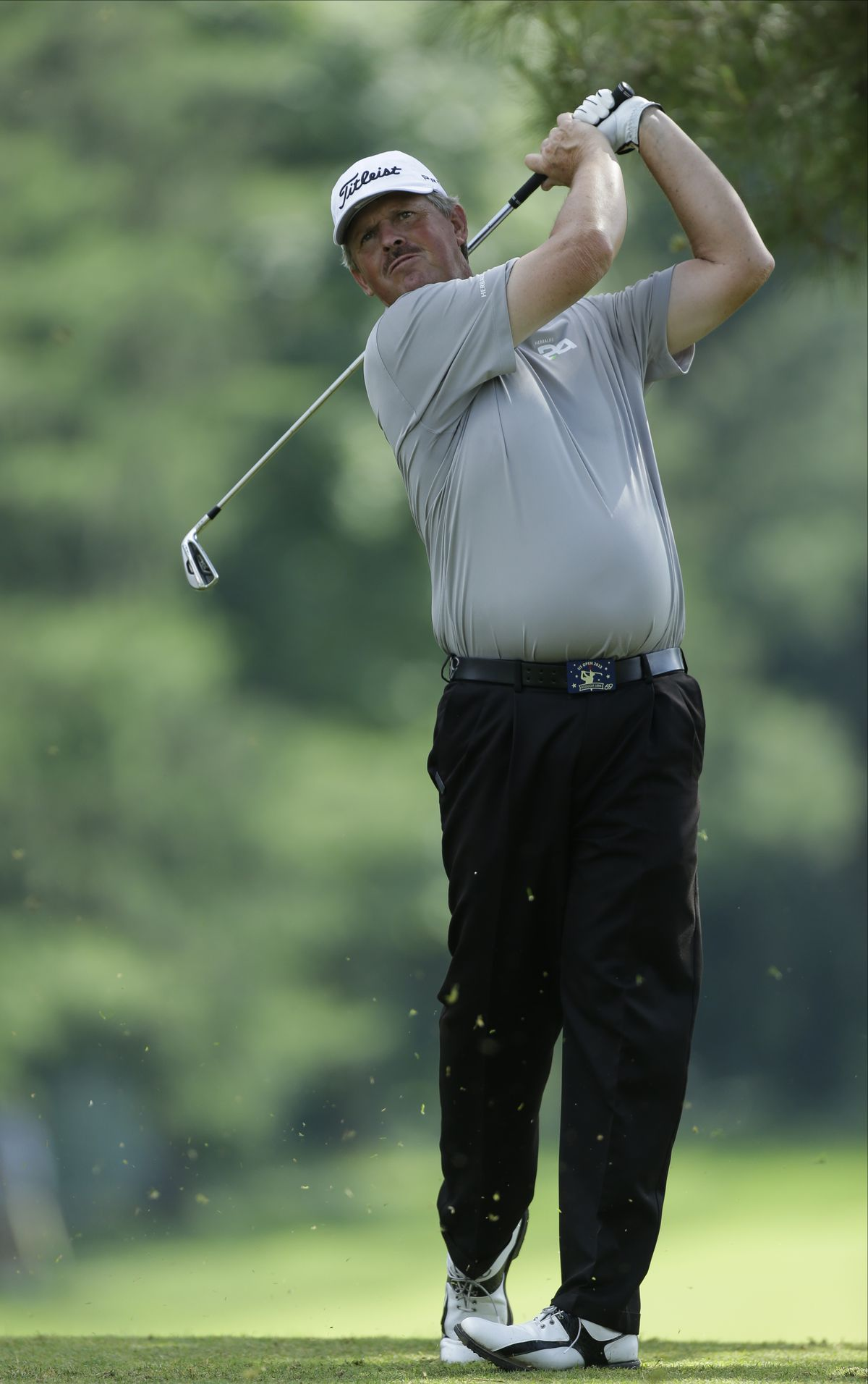 Jay Don Blake tees off on the eighth hole during the first round of the U.S. Open golf tournament at Merion Golf Club, Thursday, June 13, 2013, in Ardmore, Pa. (AP Photo/Julio Cortez)