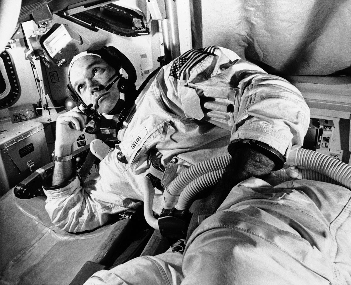 In this June 19, 1969 file photo, Apollo 11 command module pilot astronaut Michael Collins takes a break during training for the moon mission, in Cape Kennedy, Fla. Collins, who piloted the ship from which Neil Armstrong and Buzz Aldrin left to make their historic first steps on the moon in 1969, died Wednesday, April 28, 2021, of cancer, his family said. He was 90.