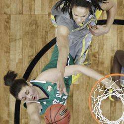 Baylor center Brittney Griner (42) knocks the ball away from Notre Dame forward Natalie Achonwa (11) during the NCAA Women's Final Four college basketball championship game, in Denver, Tuesday, April 3, 2012.  Baylor won the championship 80-61. (AP Photo/Eric Gay)