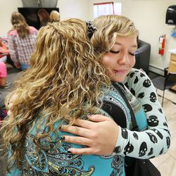 Jeannie Ybarra, of Salt Lake County Criminal Justice Services, left, hugs Intensive Supervision client Amanda Newsome at Valleycore for Women in Salt Lake City on Thursday, Oct. 6, 2016.