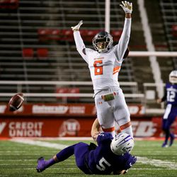 Skyridge's Jairus Satiu is charged with pass interference as Lehi's Dallin Holker falls in the 5A football state championship game at Rice-Eccles Stadium in Salt Lake City on Friday, Nov. 17, 2017.