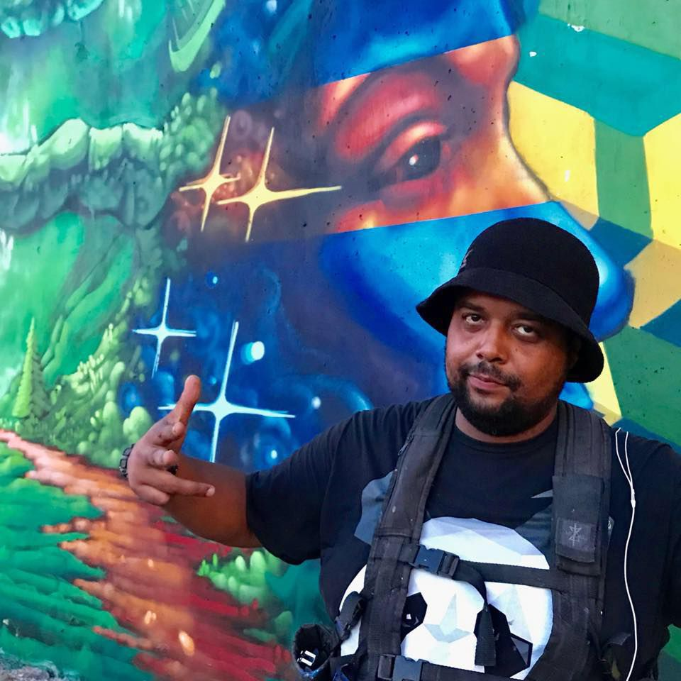 Rahmaan Statik, 40, says he was inspired to be an artist in part by MF DOOM. Statik recently painted a mural of the late rapper near Hubbard and Green streets.