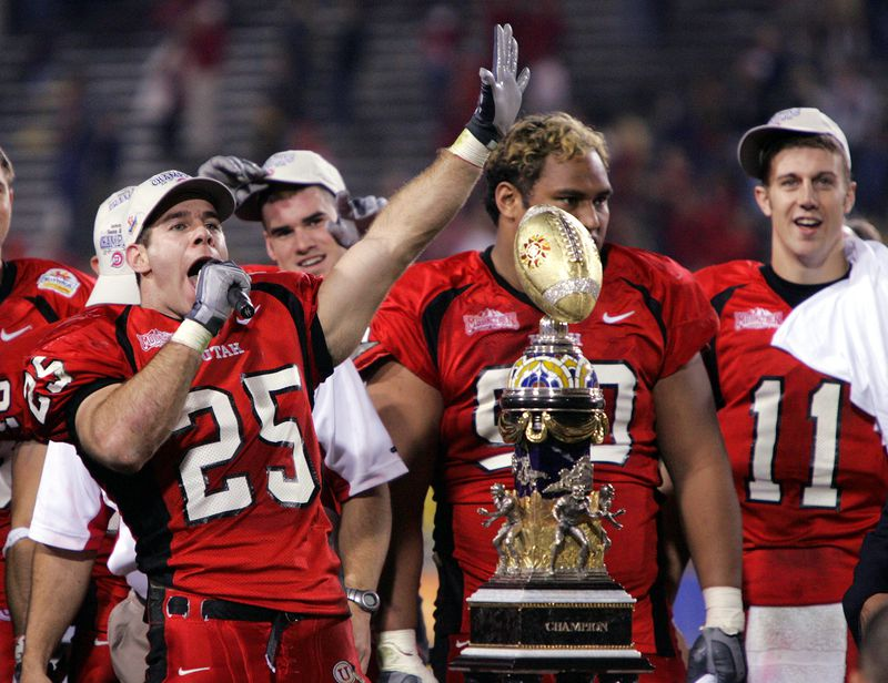 Morgan Scalley, Sione Pouha and Alex Smith clebrate their victory of the 2005 Fiesta Bowl in Tempe, AZ., Jan 1, 2005. Photo by Jeffrey D. Allred/Deseret News. He was also named a second-team All-American by the Associated Press and SI.com.