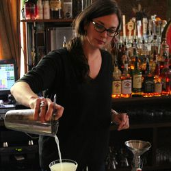 Sonny's bar manager Christina Klein pours a drink.