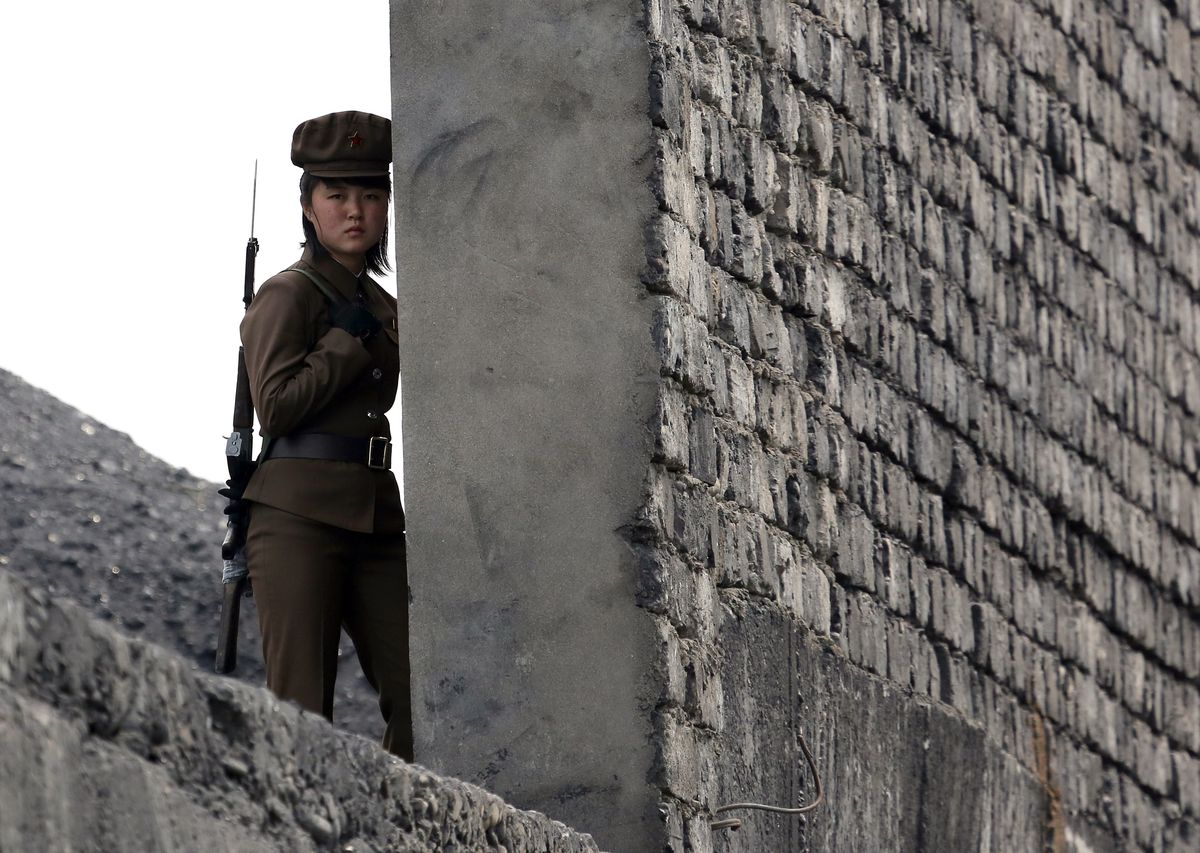 A North Korean soldier patrols the border with China (STR/AFP/Getty)