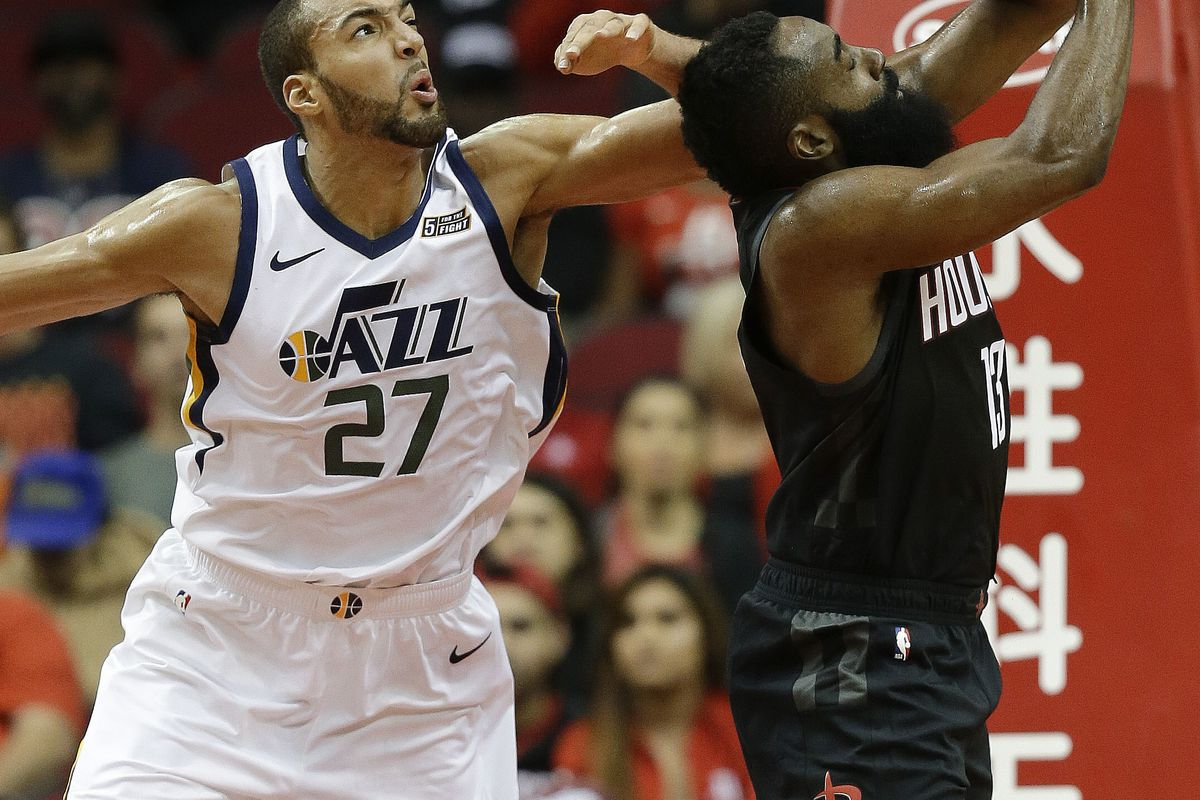 Houston Rockets guard James Harden, right, and Utah Jazz center Rudy Gobert vie for a loose ball during the first half of an NBA basketball game, Wednesday, Oct. 24, 2018, In Houston. (AP Photo/Eric Christian Smith)