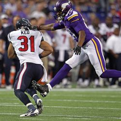 Aug 9, 2013; Minneapolis, MN, USA; Houston Texans defensive back Shiloh Keo (31) is tackled by Minnesota Vikings wide receiver Jerome Simpson (81) after intercepting a pass during the first quarter at the Metrodome.