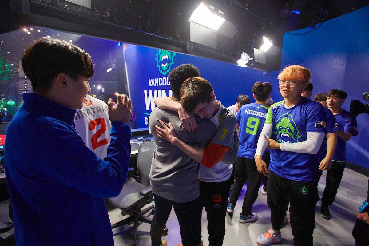 Overwatch - the Vancouver Titans celebrate on stage after their first championship.