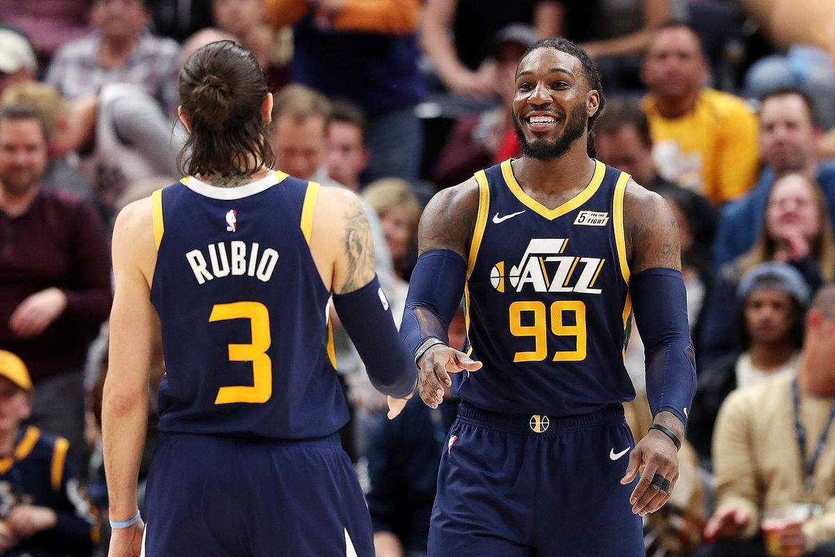 Utah Jazz forward Jae Crowder (99) smiles at teammate  Ricky Rubio after receiving a technical foul during Utah's game with the  Las Angeles Lakers at Vivint Arena in Salt lake City on Wednesday, March 27, 2019. Utah won 115-100. The Jazz appear on a roll