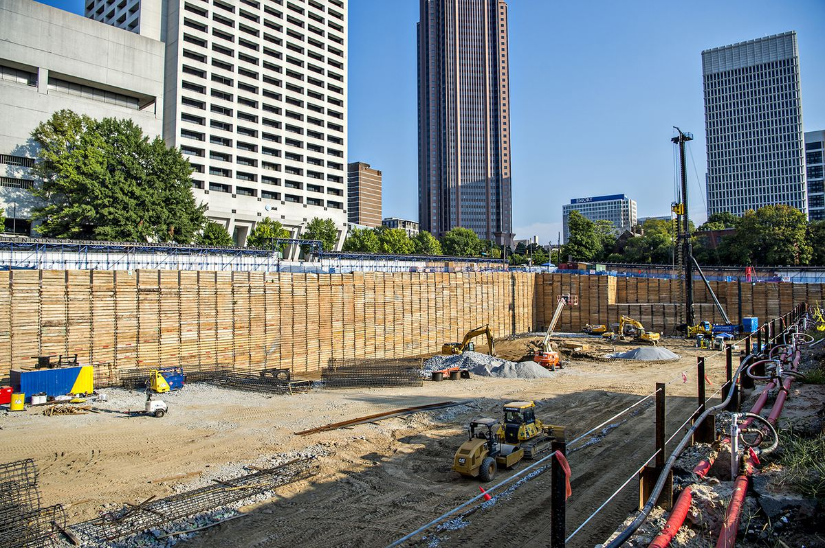 The former parking lots and small brick building at 650 West Peachtree Street are gone.