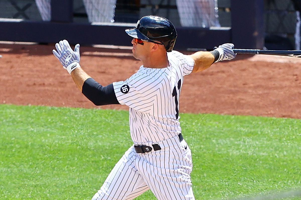 Brett Gardner #11 of the New York Yankees hits a RBI sacrifice fly in the second inning against the Detroit Tigers at Yankee Stadium on May 02, 2021 in New York City.