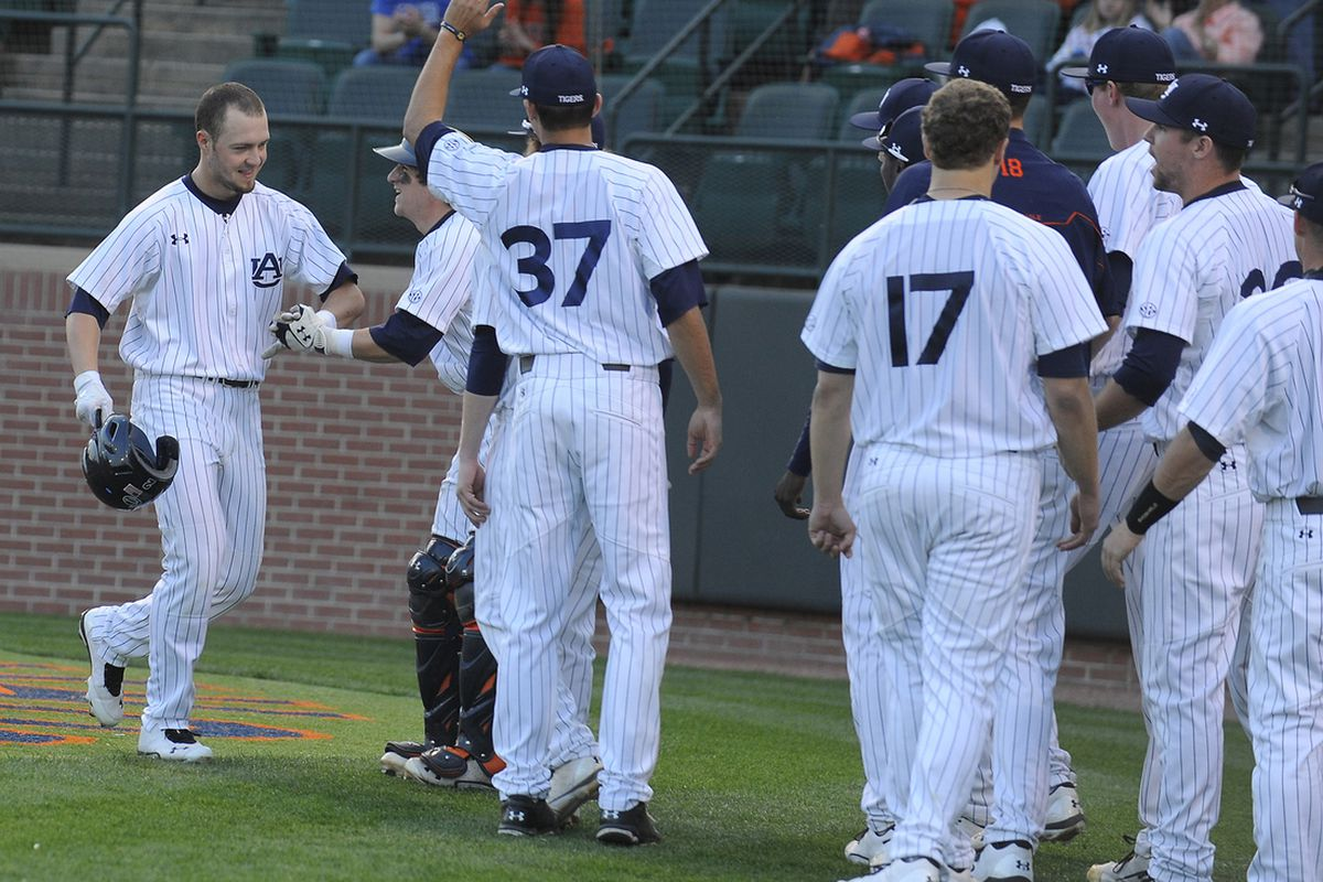 Hunter Kelley congratulated after his home run.