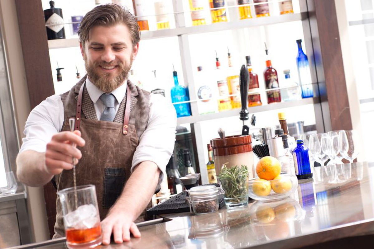 Justin Hampton mixing holiday cocktails at Poste