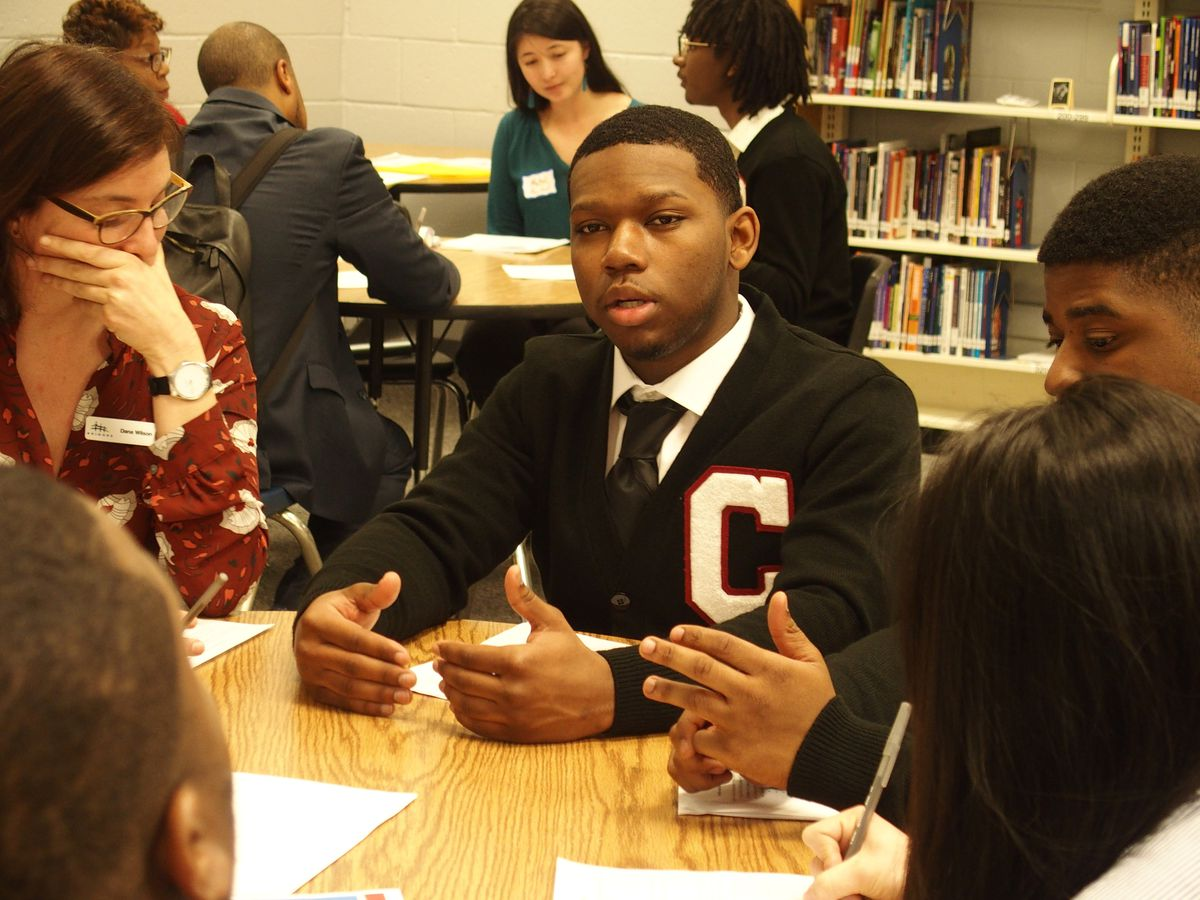 Cameron Al-Wali, a senior at G.W. Carver College and Career Academy leads a discussion on considering paths other than college after high school.