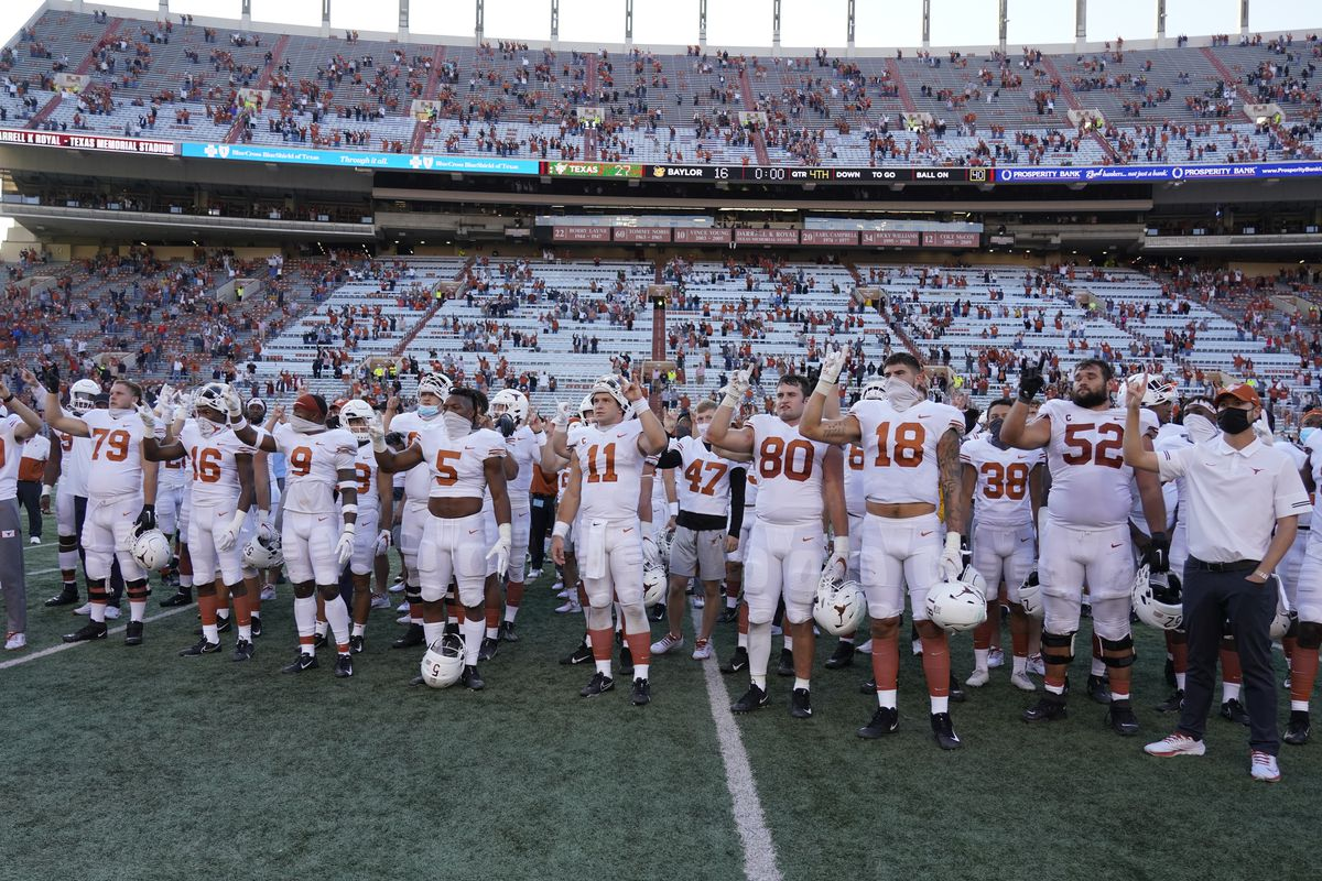 """The University of Texas' report on the history of the school song """"The Eyes of Texas"""" found it had """"no racist intent,"""" but the school will not require athletes and band members to participate in singing or playing it at games and campus events."""