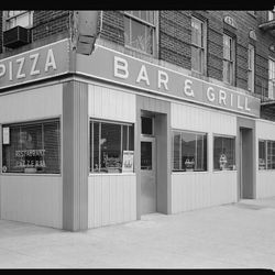 """Golf Café, Pizza Bar and Grill, exterior NE corner, Gun Hill Road and Jerome Avenue in the Bronx. <span class=""""credit""""> <a href=""""http://collections.mcny.org/C.aspx?VP3=SearchResult_VPage&VBID=24UP1GYYZKR6&SMLS=1/"""">[link]</a></span>"""