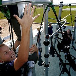 Cole Green, 11, plays on the new electronic interactive playground at Legacy Park in Layton Tuesday. Its ribbon-cutting is today.