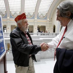 Veterans Don Wardle, left, and Andrew Wilson chat after the House of Representatives gave unanimous support to rededicate the Veterans Memorial Highway, otherwise known as I-15, at the state Capitol in Salt Lake City, Utah, on Friday, Feb. 10, 2012. Wilson is the publisher of UTVet.com