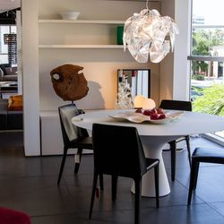 Hope Chandelier by Luceplan ; Blanco Table by Zanotta ; Isabel Chair by Flexform