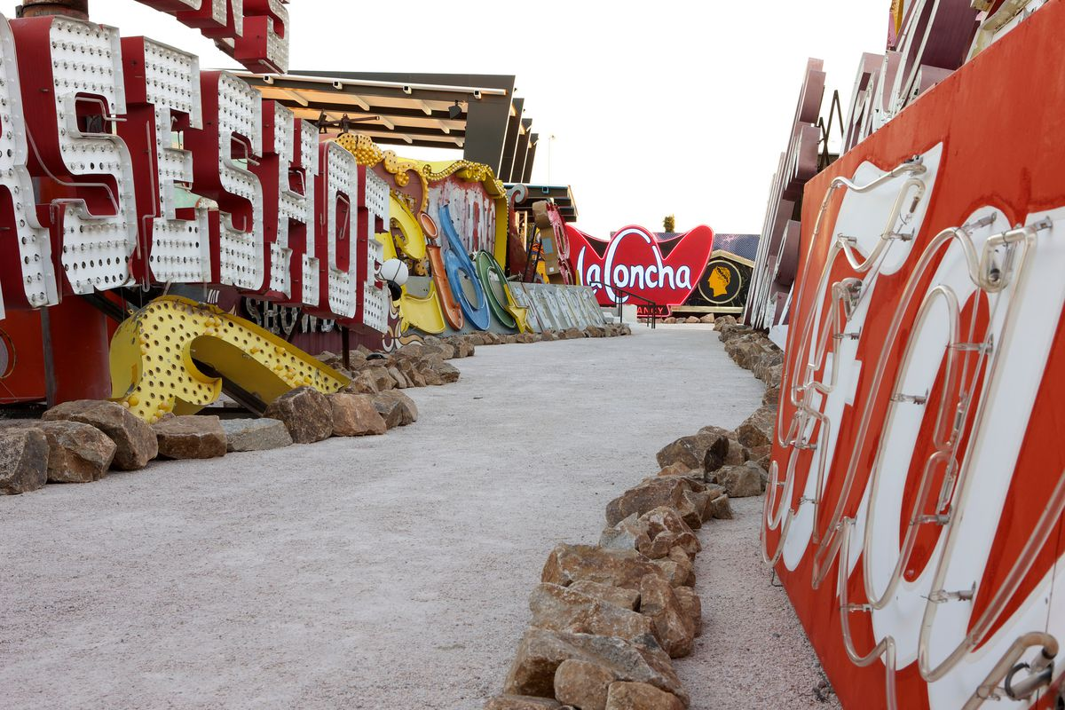 Large neon signs are on the ground at the Las Vegas Neon Museum.